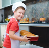 Boy making bread Royalty Free Stock Photos