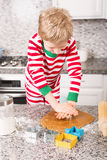 Boy making cookies Royalty Free Stock Image