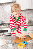 Boy making cookies Stock Photography
