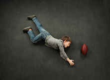 Boy making a diving catch for football Stock Photos