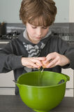 Boy making the dough for the cakes Stock Photography