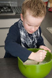 Boy making the dough for the cakes Royalty Free Stock Image