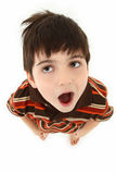 Boy Making Faces Looking Up Stock Photography