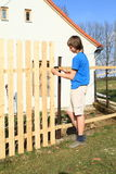 Boy making fence Royalty Free Stock Photography