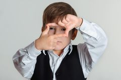 Boy making frame with hands Royalty Free Stock Photography