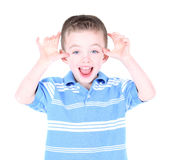 Boy making a funny face. Isolated on white Royalty Free Stock Images