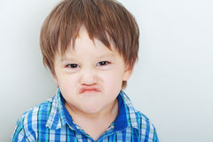 Boy making funny faces Stock Photography