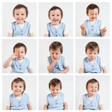 Boy, making funny faces on a white background Royalty Free Stock Photo