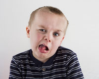 Boy making funny faces Stock Images
