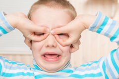 Boy making glasses his hands  portrait Royalty Free Stock Photography