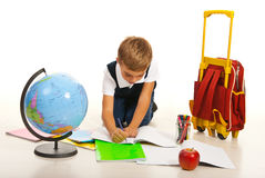 Boy making homework Royalty Free Stock Image