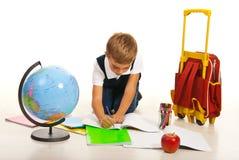 Boy making homework Royalty Free Stock Image