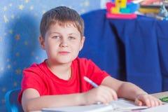 Boy making homework Royalty Free Stock Photos