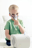 Boy making inhalation with nebulizer at home Royalty Free Stock Image