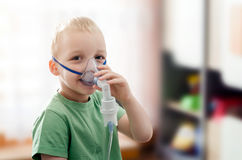Boy making inhalation with nebulizer at home Stock Photography