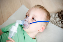 Boy making inhalation with nebulizer at home Royalty Free Stock Photo