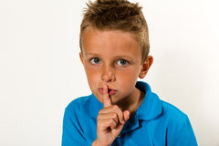 Boy making keep quiet gesture Royalty Free Stock Images