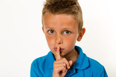 Boy making keep quiet gesture Stock Photo