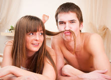 Boy is making a mustache of girl's hair Stock Photography