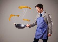 Boy making pancakes Royalty Free Stock Photo