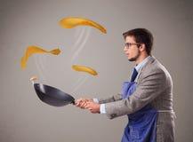 Boy making pancakes Royalty Free Stock Images