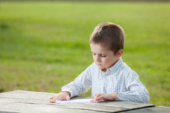 Boy making paper plane Stock Photos