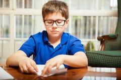 Boy making a paper plane Stock Photo