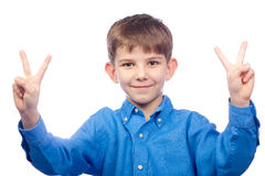 Boy Making Peace Sign Stock Images