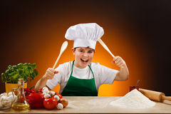 Boy making pizza dough Royalty Free Stock Images