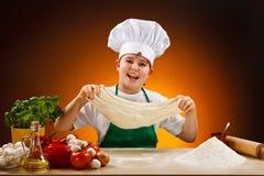 Boy making pizza dough royalty free stock photography