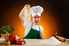 Boy making pizza dough Royalty Free Stock Photo