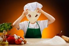 Boy making pizza dough Royalty Free Stock Photo