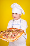 Boy making pizza Royalty Free Stock Photography
