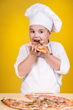 Boy making pizza Royalty Free Stock Images