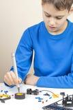 Boy making robot car. Robotic, learning, technology, stem education for children background stock images
