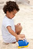 Boy making sand castle Royalty Free Stock Photo