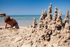 Boy making sand castle on beach Royalty Free Stock Photography