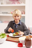 Boy Making Sandwich In Kitchen Royalty Free Stock Photography