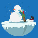 Boy making snow man Royalty Free Stock Images