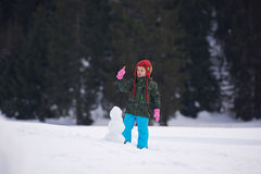 Boy making snowman in wintwr Royalty Free Stock Photo