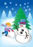 Boy making snowman Royalty Free Stock Image