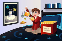 Boy making a solar system science project Stock Image