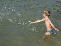 Boy making a splash stock photos