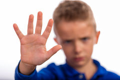 Boy making a stop gesture with his hand Royalty Free Stock Images