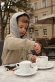 Boy making tea. A boy with a tea Royalty Free Stock Photos