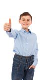 Boy making thumbs up sign Stock Photos