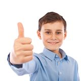 Boy making thumbs up sign Stock Images