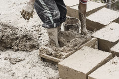 Boy making traditional adobe mud bricks in Paru Paru Community Stock Photography