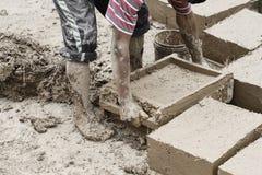 Boy making traditional adobe mud bricks in Paru Paru Community Stock Photos