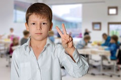 Boy making victory sign Stock Photography